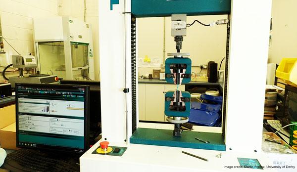 Image of machine measuring mesh breaking strength