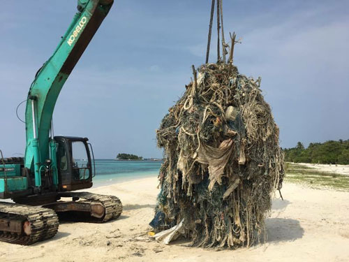 Huge ghost net removed by crane Maldives