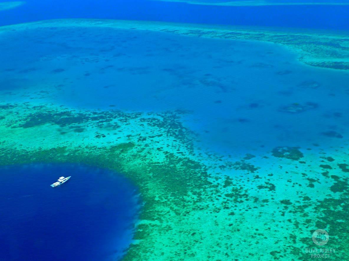 Aerial Maldives boat near reef