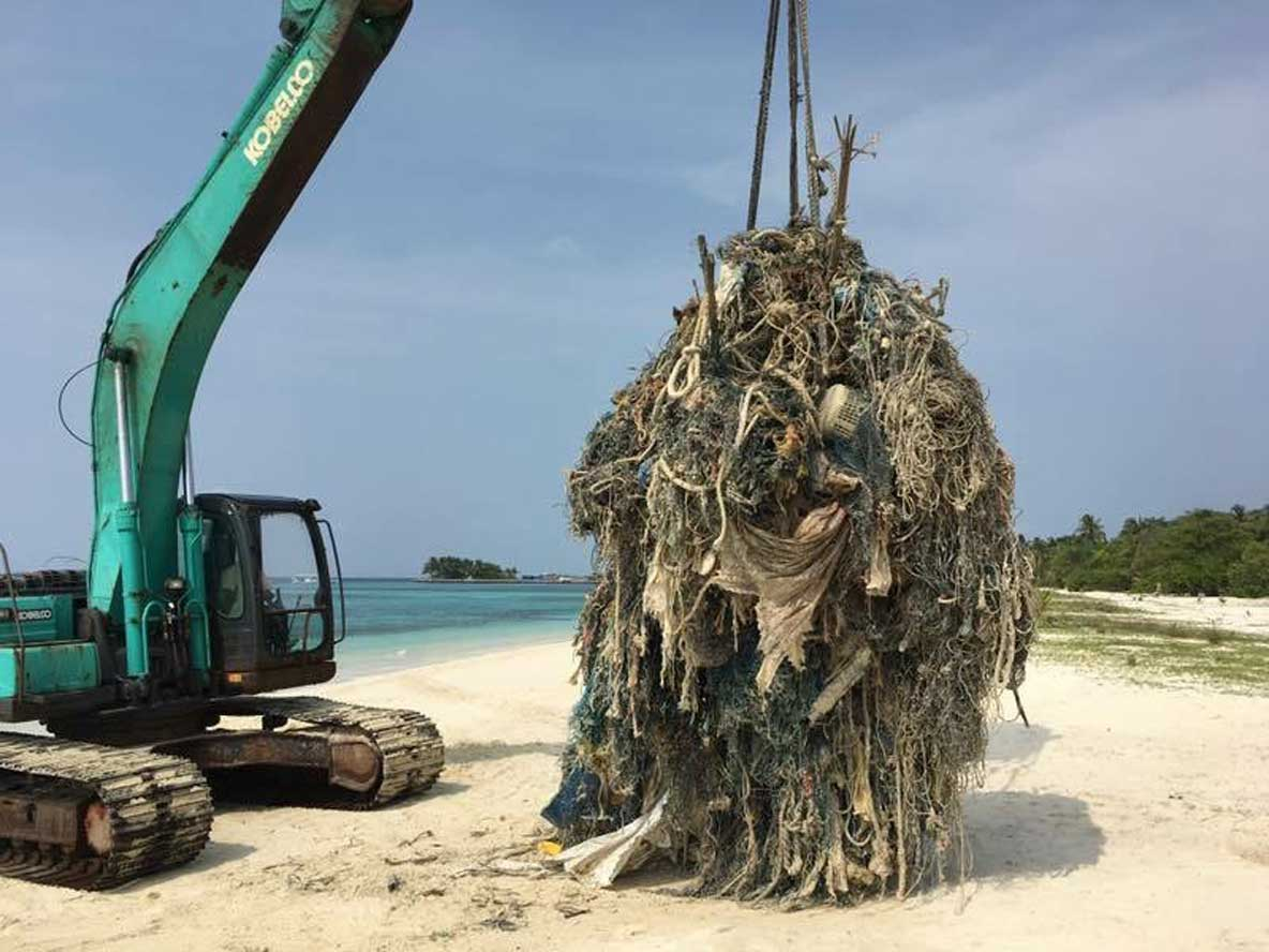 Huge ghost net removed from ocean by crane Maldives