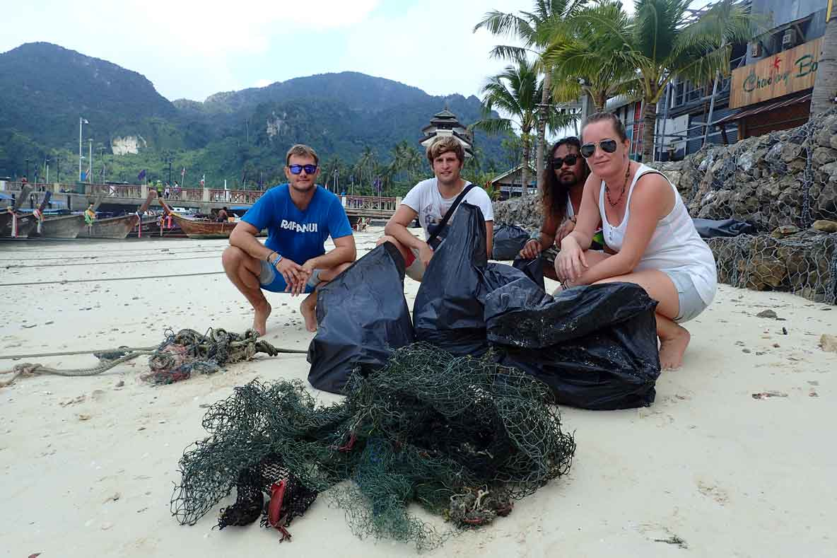 Blue View Divers and ORP volunteers with ghost nets catch on beach in Thailand
