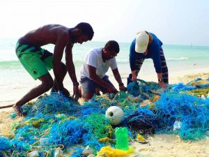 Ghost net dismantling on the beach Ha.Kelaa Maldives