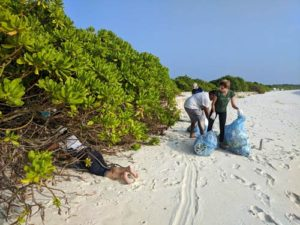 Beach cleanup at Kelaa Island Maldives