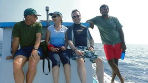 ORP's expedition volunteers with Shameel on the boat