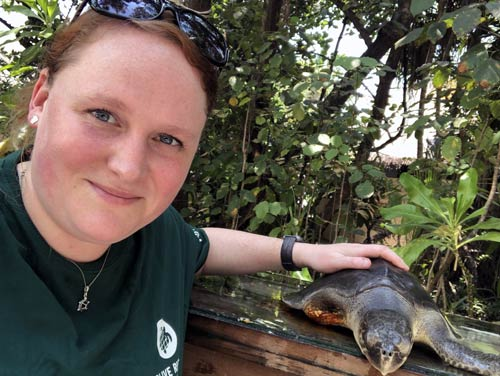 Visiting Veterinarian Sonya Miles with one of the turtle patients she helped care for at the ORP Marine Turtle Rescue Centre, Maldives