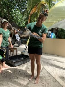 Rolex Scholar Kim with turtle patient Elba who is ready to practice diving skills in the big tank at the ORP Turtle Rescue Centre