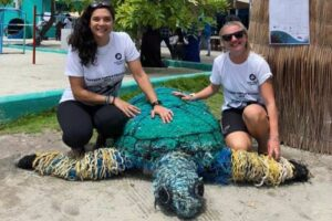 Dr. Claire Petros and Laura Whiteley from ORP with the ghost gear turtle mascot