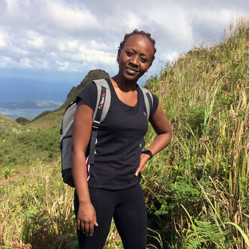 Leah Mainye, a marine biologist in Kenya, on a hike in the mountain. Image.