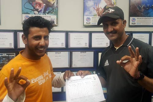 Alam and Asif Baloch after passing the PADI Open Water Certification exam.