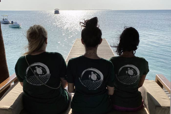 Karam enjoying the sea view with two volunteers, image