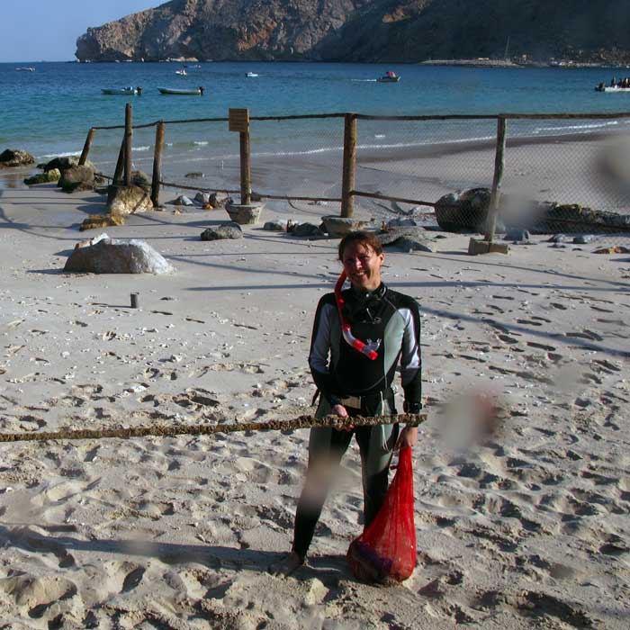 Women in science: Jane Lloyd on the beach after a dive to collect marine debris near Zighy Bay in Oman.