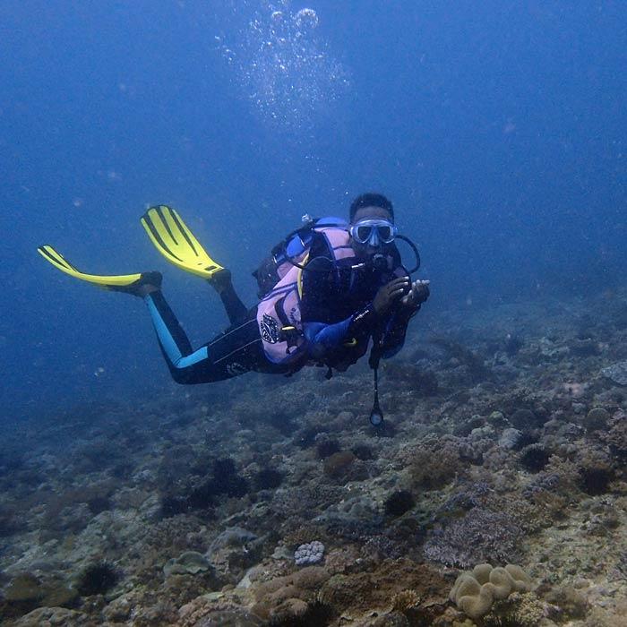 """Leah Mainye in her """"underwater office"""" in Diani Beach, Kenya."""