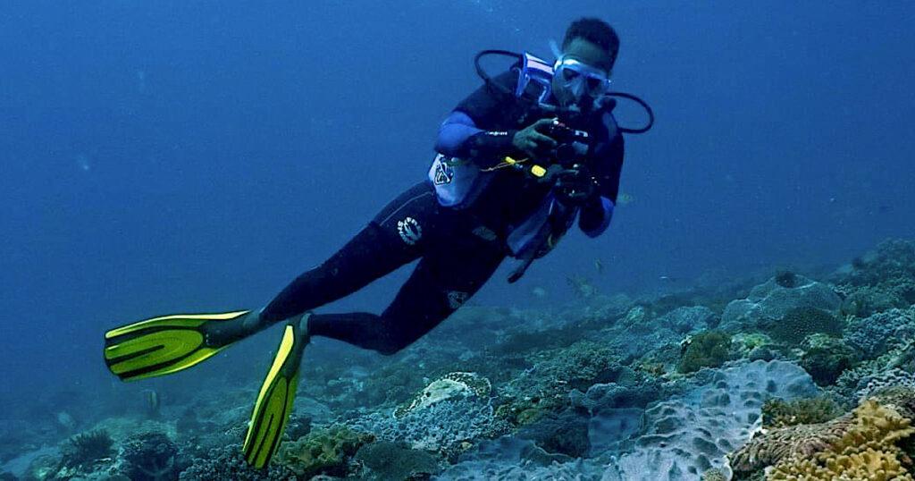 Leha Mainye, marine biologist, conducting turtle photo-id in Kenya. Underwater image.