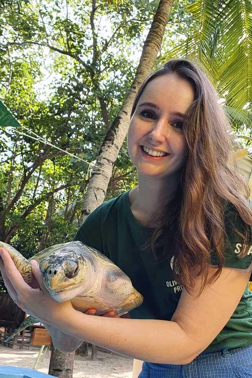 Turtle Vet Dr. Minnie with turtle patient Arti. Image.