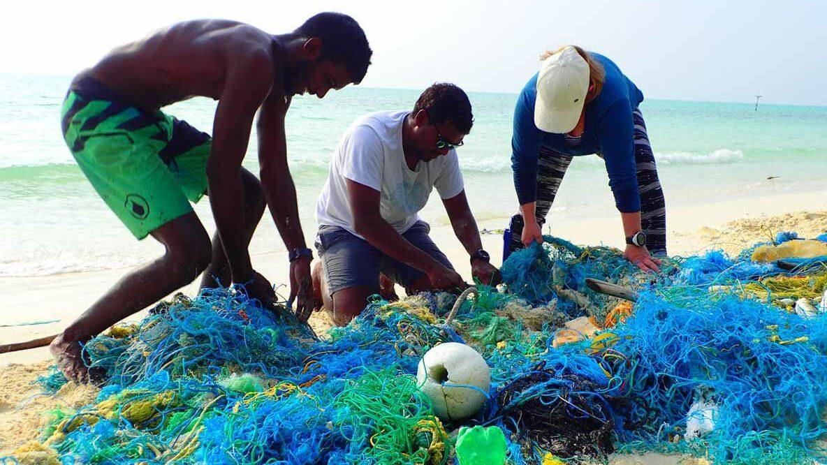 Volunteers dismantling ghost nets on the beach in Ha.Kelaa, Maldives.Image.