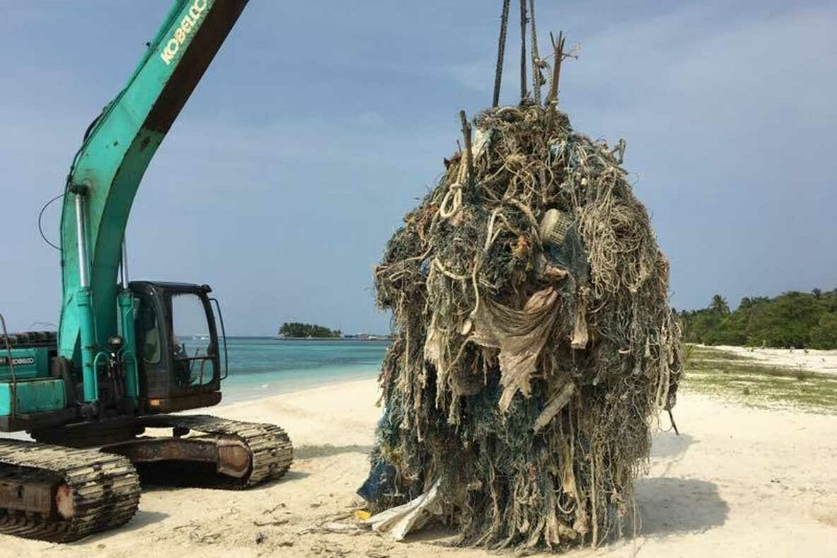 Huge ghost net needing crane to be removed Maldives. Image.