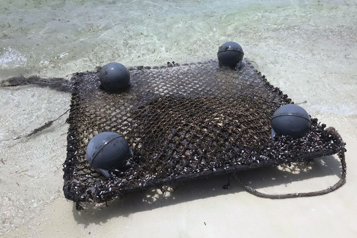 dFAD (Fish Aggravating Device)washed up on the beach in the Maldives. Image.