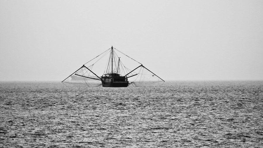 A trawler fishing vessel at sea. Image.
